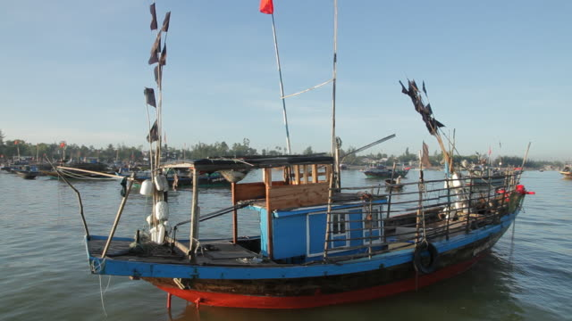 ws fishing boat floating in south china sea / vietnam - south china sea stock videos & royalty-free footage