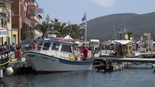 fishing boat in marina of porto azzurro - island of elba stock videos & royalty-free footage