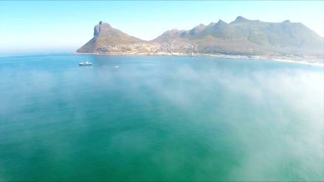 Fishing boat in mist in Hout Bay South Africa