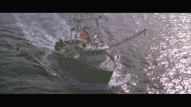 vidéos et rushes de aerial fishing boat in sea - chalutier