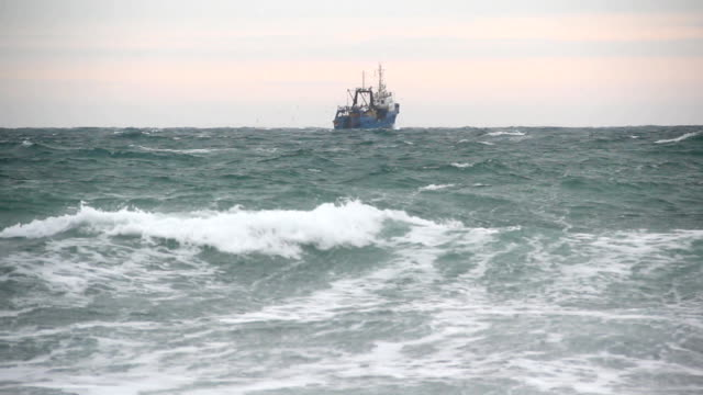 fishing boat in the sea - nautical vessel stock videos & royalty-free footage