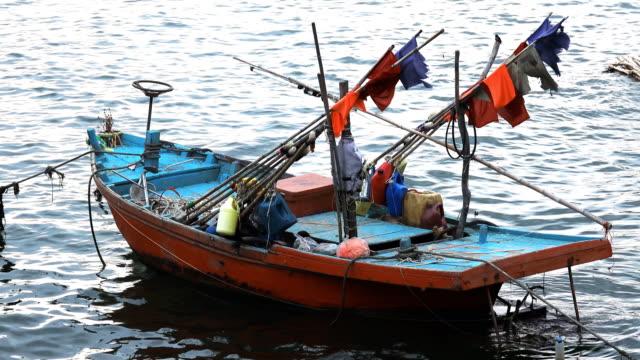 vídeos de stock e filmes b-roll de fishing boat in the sea. - navio pesqueiro