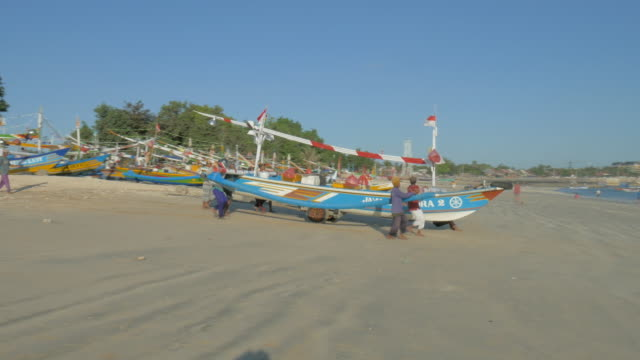 Fishing Boat Launching at Jimbaran Beach,Bali,Indonesia