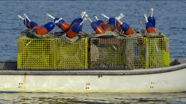 fishing boat loaded with empty lobster traps and buoys - eastern usa stock videos & royalty-free footage