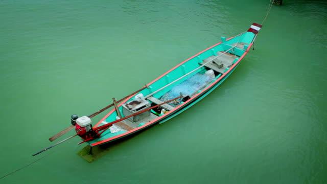 fishing boat moored at sea - aquatic organism stock videos & royalty-free footage