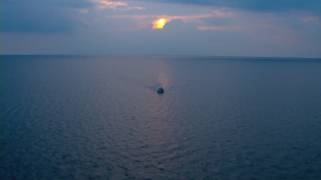 a fishing boat moves through the gulf of mexico at golden hour. - golden hour stock videos & royalty-free footage