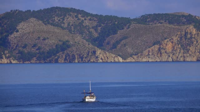 fishing boat near s'illot, badia de pollenca, cap formentor, majorca, balearic islands, spain, mediterranean, europe - mediterranean culture stock videos & royalty-free footage