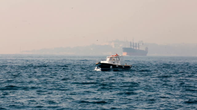 fishing boat on bosphorus - istanbul view - bosphorus stock videos & royalty-free footage