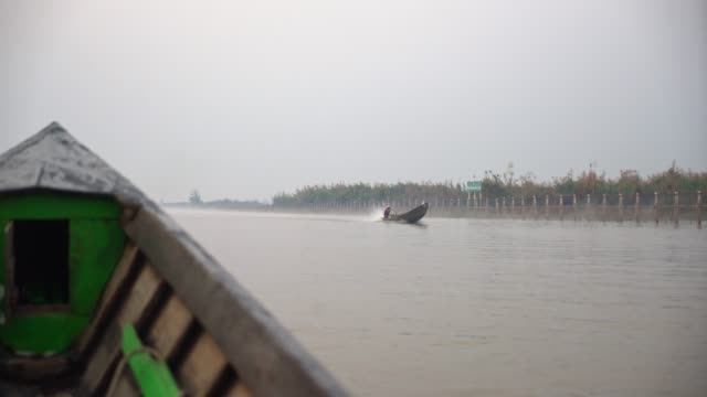 fishing boat on inle lake - cambodia stock videos & royalty-free footage