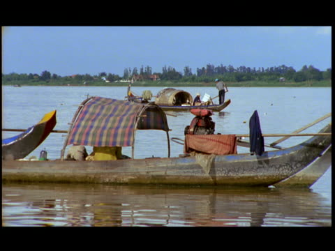 ms, fishing boat on mekong river, china - sampan stock videos & royalty-free footage