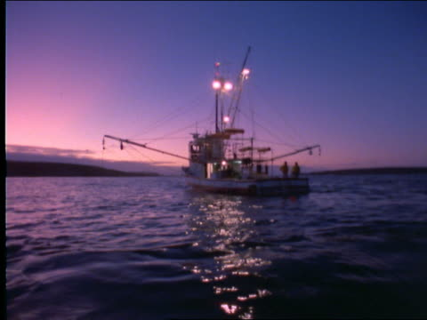 fishing boat on ocean at twilight - cinematography stock videos & royalty-free footage