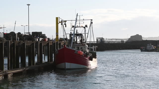 fishing boat on the island of jersey, united kingdom on saturday, may 8, 2021 following protests by french fishing vessels over fishing rights. - 男漁師点の映像素材/bロール