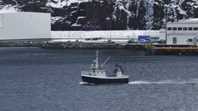 fishing boat sailing in a fjord - atlantic ocean stock videos & royalty-free footage
