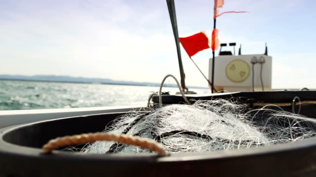 Fishing boat sailing out at sea