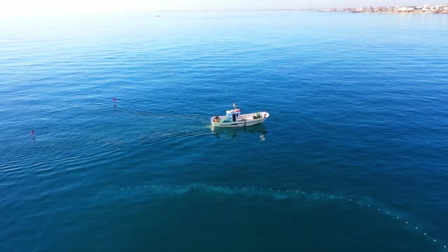 fishing boat seen from drone - netting stock videos & royalty-free footage