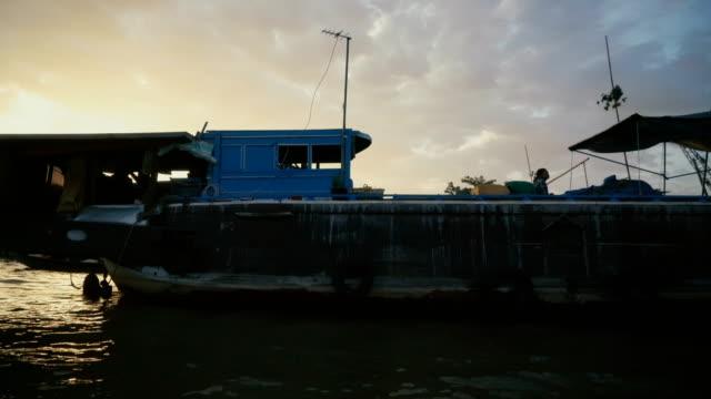 fishing boat through mekong delta - mekong delta stock videos & royalty-free footage