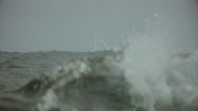 fishing boat trawler sailing a rough north sea - sailing ship stock videos & royalty-free footage