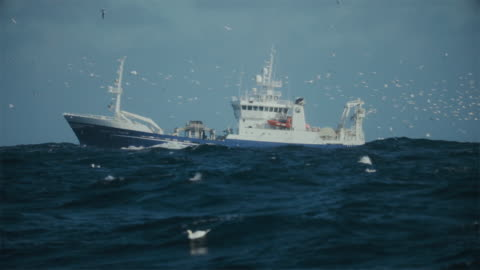 fishing boat trawler sailing a rough north sea - industrial sailing craft stock videos & royalty-free footage