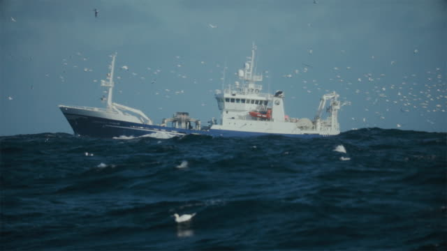 fishing boat trawler sailing a rough north sea - ship stock videos & royalty-free footage