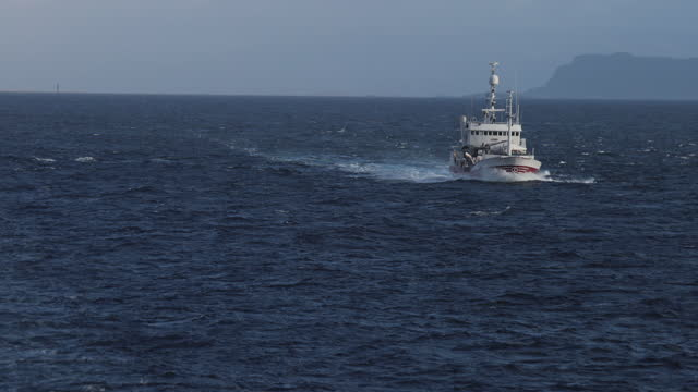 fishing boat trawler sailing out at rough sea - atlantic ocean stock videos & royalty-free footage