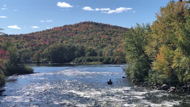 fishing boat with fisherman anchored in rapids along the androscoggin river in errol, new hampshire usa during autumn 2020 - rapids river stock videos & royalty-free footage