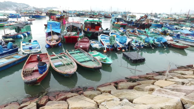 ws pan fishing boats anchored in cheung chau harbour / cheung chau, hong kong, china  - moored stock videos & royalty-free footage