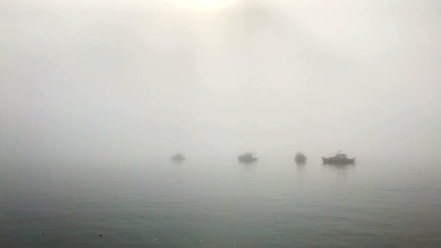 fishing boats and ferries are seen on the bosporus amid a heavy fog on march 11 2018 in istanbul turkey the heavy fog delayed early morning ferry... - istanbul stock videos & royalty-free footage