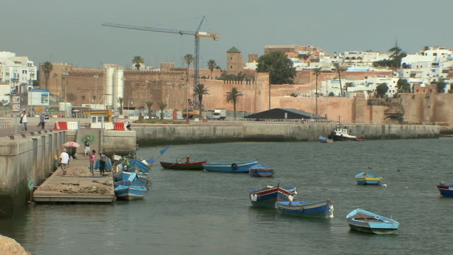 ws fishing boats at dock with walls of casbah in background, rabat, morocco - rabat morocco stock videos & royalty-free footage
