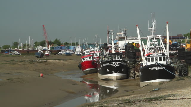 fishing boats at low tide - low tide stock videos & royalty-free footage