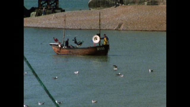 fishing boats at work in hastings, uk; 1986 - fishing stock videos & royalty-free footage