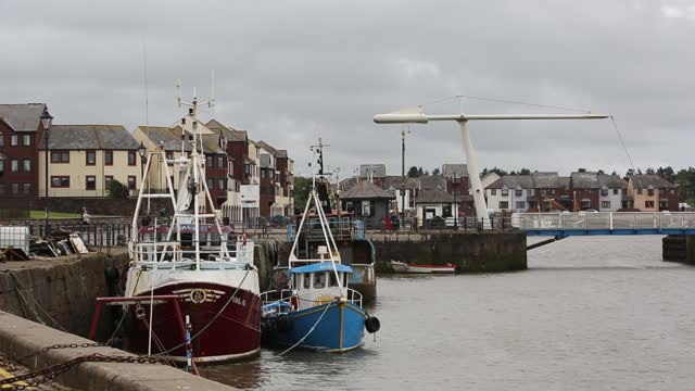 fishing boats in maryport harbour, cumbria, uk. - fishing boat stock videos & royalty-free footage