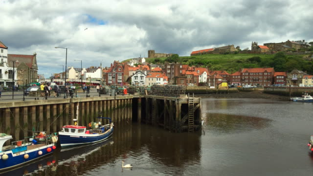 fishing boats in the port at the seaside town of whitby. - yorkshire england stock videos & royalty-free footage