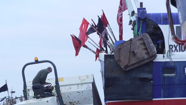 fishing boats line up on the beach in hastings u.k. on friday, january. 15, 2021. while prime minister boris johnson claimed last month's trade deal... - nautical vessel stock videos & royalty-free footage