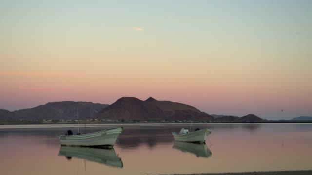 fishing boats moored near shore at sunrise / bahia san luis gonzaga, baja california norte, mexico - baja california norte stock videos & royalty-free footage