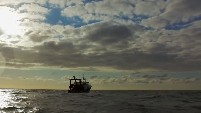 fishing boats off the coast of jersey - channel islands england stock videos & royalty-free footage