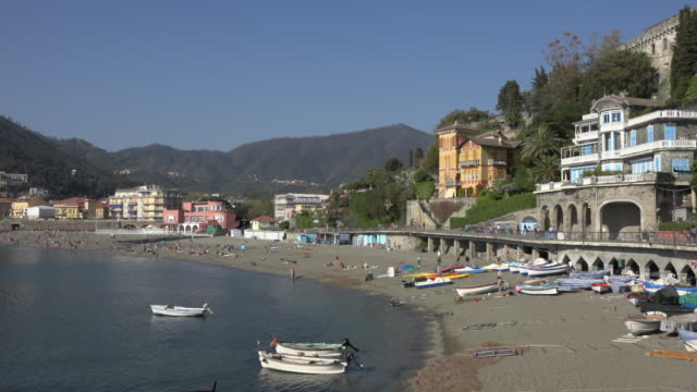 Fishing boats on beach and village of Levanto