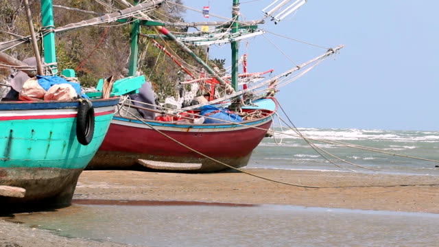 fishing boats on the beach - phi phi islands stock videos & royalty-free footage
