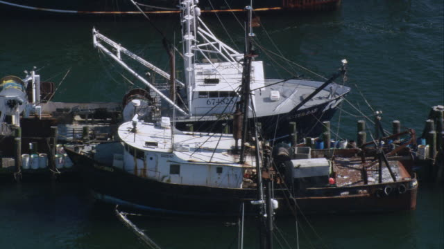 aerial fishing boats sitting in boat slip / jerusalem, rhode island, united states - nightdress stock videos & royalty-free footage