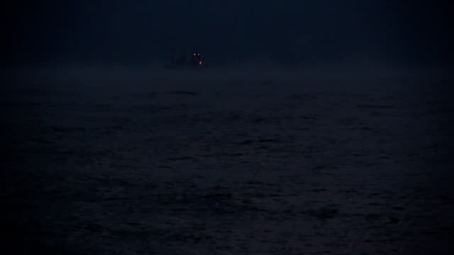 fishing boats with running lights in the night winter sea - trawler stock videos & royalty-free footage