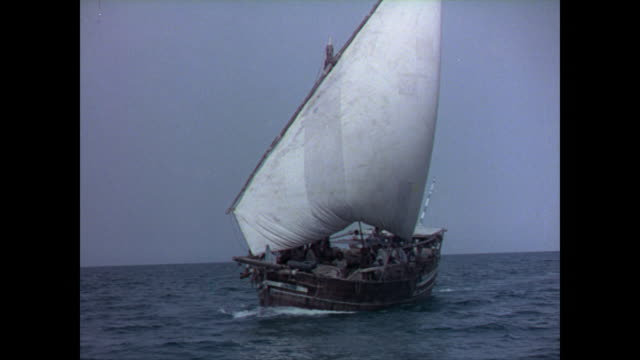 fishing dhow sailing through the persian gulf, group of men and boys looking out to sea, map if the arabian peninsula with arabic writing. - arabic script stock videos & royalty-free footage