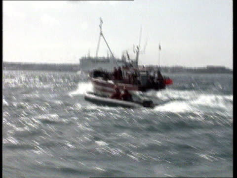 ms royal navy fisheries protection vessel at sea ms french fishing boat along track rl ms fishing boat as pulling up lobster pots track lr ms french... - guernsey stock-videos und b-roll-filmmaterial