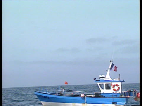 fishing dispute - britain warns france; channnel islands: french fishing boats along at sea ditto blue fishing boat along flotilla of fishing boats... - guernsey stock videos & royalty-free footage