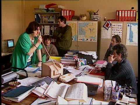 cherbourg ms french fishermen at desk in office ms ditto tilt up from map cms intvw woman sof this is provocation by the royal navy - la manche stock videos and b-roll footage