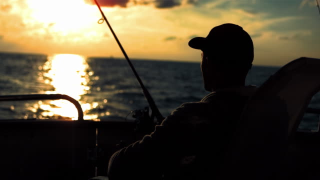 HD: Fishing From The Stern At Sunset
