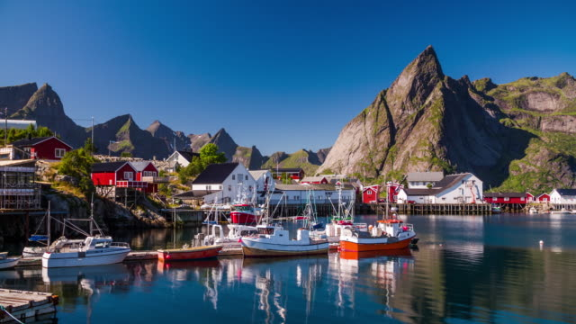 fishing harbour with rorbuer huts at lofoten islands, norway - fishing boat stock videos & royalty-free footage