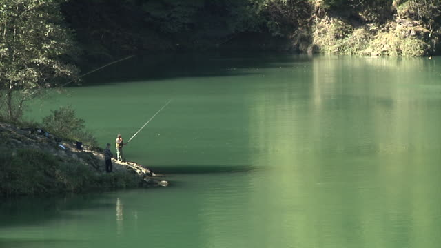 fishing in the verzasca river - ticino canton stock videos and b-roll footage