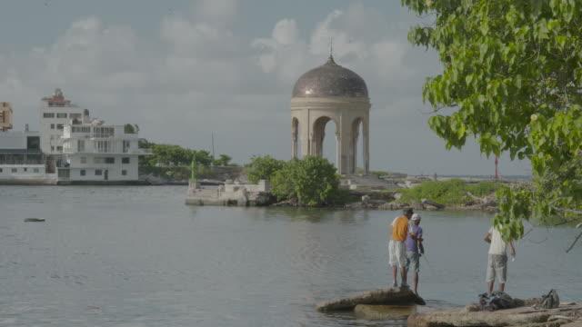 fishing in waters near domed gazebo - gazebo stock videos and b-roll footage