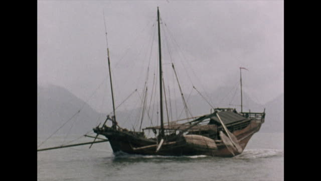 fishing junk on the south china sea; 1972 - fischnetz stock-videos und b-roll-filmmaterial
