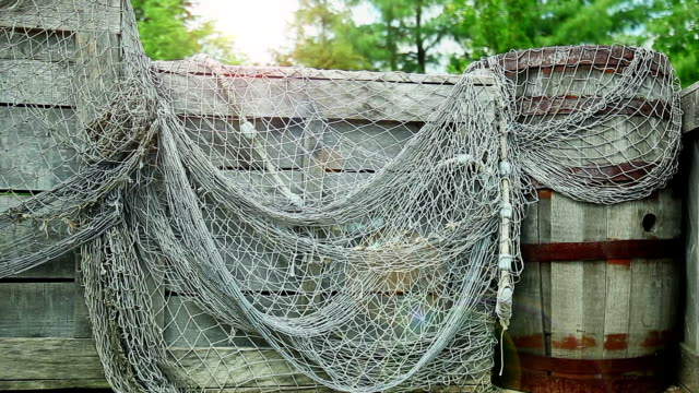 fishing net on wooden storage. back view. - cage stock videos & royalty-free footage