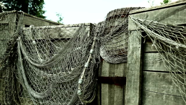 fishing net on wooden storage - close up - storage compartment stock videos and b-roll footage